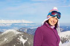 Smiling girl in winter mountains Stock Photography