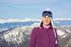 Smiling girl with winter panorama Royalty Free Stock Photos