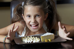 Smiling Girl With Cheese Royalty Free Stock Photography