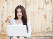 Smiling Girl With Laptop And Apple Royalty Free Stock Photos