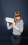 Smiling Girl With Sale Sign Stock Images
