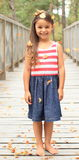 Smiling girl on wooden bridge Stock Images