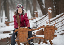 Smiling girl on woody cow. A caucasian 9 years old girl at woody playground. Pre-adolescent girl sitting on woody cow Stock Photography