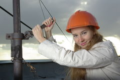 Smiling girl at work Stock Image