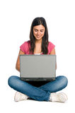 Smiling girl working on laptop Royalty Free Stock Images