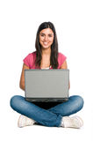 Smiling girl working on laptop Stock Images