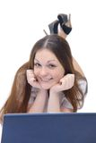 Smiling girl works with the laptop Stock Photos