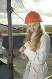Smiling girl with a wrench Stock Photos