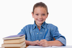 Smiling girl writing on a notebook Stock Photo