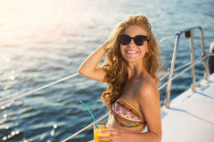 Smiling girl on yacht. Royalty Free Stock Photo
