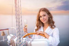 Smiling girl at yacht wheel. Stock Images