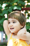 Smiling girl in yellow Royalty Free Stock Image