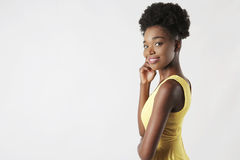 Smiling girl in a yellow dress royalty free stock images