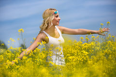 Smiling girl in yellow  field Royalty Free Stock Photography