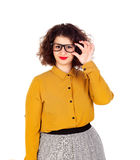 Smiling girl with yellow shirt and glasses Royalty Free Stock Photos