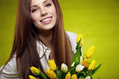 Smiling girl with yellow tulips. Royalty Free Stock Photos