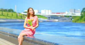 Smiling girl with yellow tulips Royalty Free Stock Photo