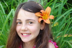 Smiling Girl. Young girl with a flower in her hair Stock Image
