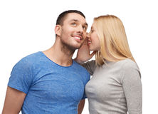 Smiling girlfriend telling boyfriend secret Royalty Free Stock Images