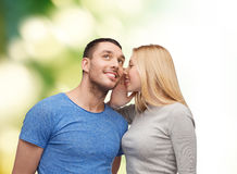 Smiling girlfriend telling boyfriend secret Stock Photography