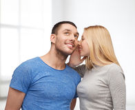 Smiling girlfriend telling boyfriend secret Royalty Free Stock Image