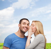 Smiling girlfriend telling boyfriend secret Royalty Free Stock Photo