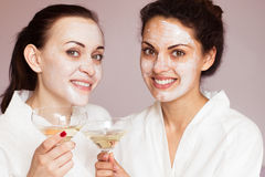 Smiling girlfriends with champagne in the spa Royalty Free Stock Photography