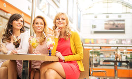 Smiling girlfriends enjoying their dessert Royalty Free Stock Photos