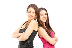 A smiling girlfriends standing close together  Stock Images