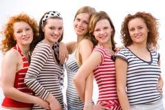 Smiling girls. Group of five beautiful girls having fun Royalty Free Stock Images