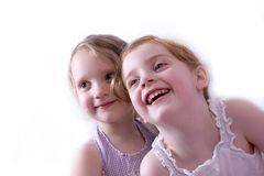 Smiling girls. High-key portrait of happy little girls Stock Images