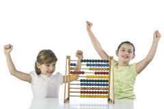 Smiling girls with abacus stock photo
