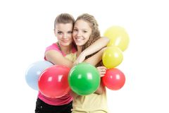 Smiling girls with balloons over white Stock Photos