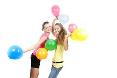 Smiling girls with balloons over white Stock Image