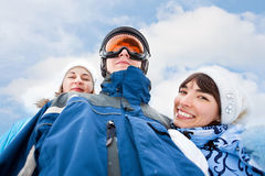 Smiling girls in blue and man in sky mask Royalty Free Stock Image