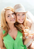Smiling girls with champagne glasses Stock Photos