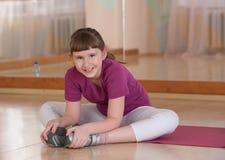 Smiling girls engaged in physical training. Smiling girls engaged in physical training in the gym. Horizontal Royalty Free Stock Image