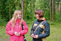 Smiling girls in forest Stock Photo