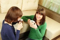 Smiling girls have tea Royalty Free Stock Images