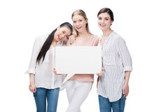 Smiling girls holding blank speech bubble isolated on white Royalty Free Stock Image
