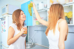 Smiling girls in kitchen Stock Photography