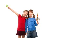 Smiling girls with lollipop Royalty Free Stock Images