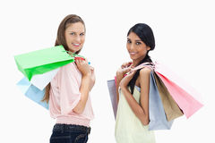 Smiling girls with a lot of shopping bags Royalty Free Stock Image