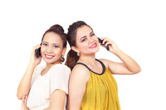Smiling girls on phone Royalty Free Stock Photography