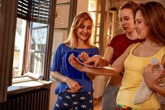 Smiling girls planning choreography of hip hop dancers stock images
