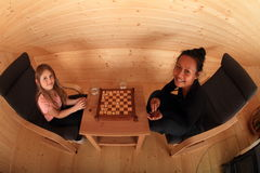 Smiling girls playing draughts Stock Photo