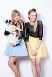 Smiling girls with pug dog. Stock Image