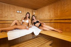 Smiling girls in a sauna Royalty Free Stock Photo