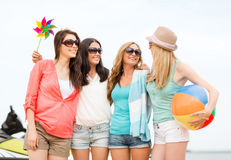 Smiling girls in shades having fun on the beach Royalty Free Stock Image