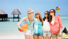 Smiling girls in shades having fun on the beach Stock Photo